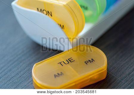 Close-up of medicine dose box. Prescription pills in a pill box.