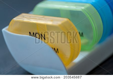 Close-up of medicine dose box. Prescription pills in a pill box.