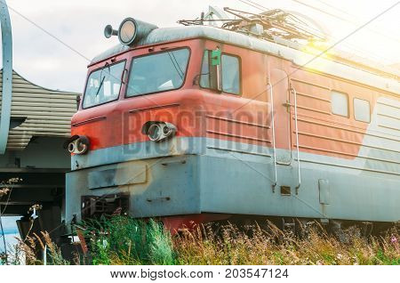 Locomotive Electric With A Freight Train At High Speed Rides By Rail