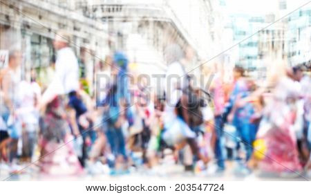 Walking people in the City of London. Multiple exposure image, modern life concept.