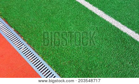 Sport Background. Decorative coating at the stadium. Modern outdoor elastic plastic coating for running tracks and athletic fields top