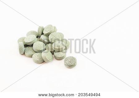 Spirulina Pills with B12. White background .