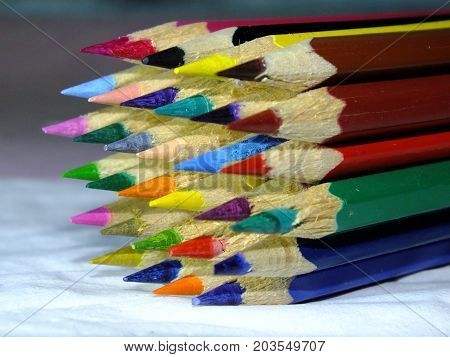 a collection of colored pencils whose edges have been pointed