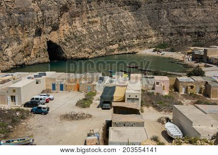 DWEJRA MALTA - AUGUST 22 2017: The Inland Sea (Qawra Dwejra) is a lagoon of seawater on the island of Gozo linked to the Mediterranean Sea through an opening formed by a narrow natural arch