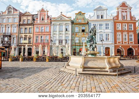 View on the beautiful old buildings with Neptune fountain on the Maket square in Poznan city during the morning light in Poland
