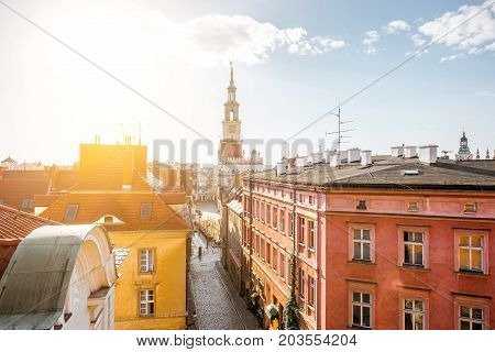 Cityscape view on the old town with town hall tower in Poznan during the sunrise in Poland