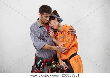 Repair, Building, People And Relationships Concept. Young Repairman Wearing Uniform Trying To Calm H