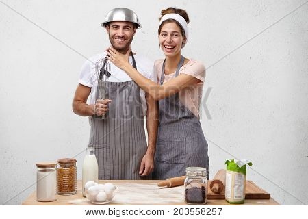 Funny Best Friends Cook Together At Kitchen, Have Joyful Expression After Cooking Tasty Dinner. Youn