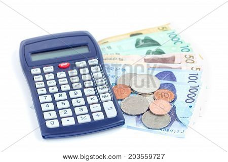 Different value South korean currency near the calculator save your money concept isolated