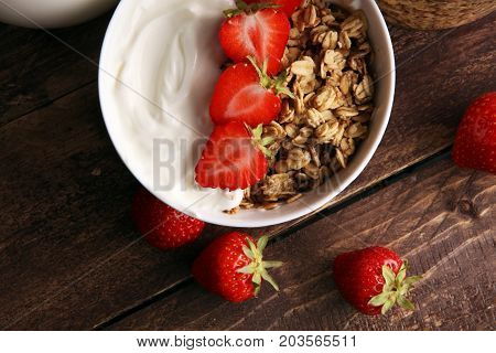 Healthy Breakfast Concept With Oat Flakes And Fresh Berries On Rustic Background. Food Made Of Grano