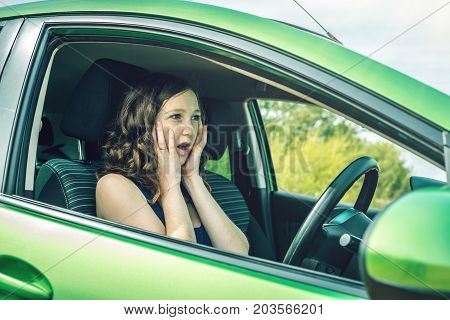 Woman Behind The Wheel Frightened. The Traffic Violation.