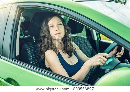 Woman In The Car. Hands On The Wheel. Focused And Tense. Lesson In Driving School.