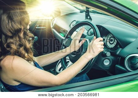Closeup Of Female Hand On The Steering Wheel Presses The Horn Button In The Car. Concept Irritation