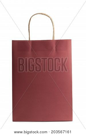 Mockup blank of paper shopping bag isolated on white background. Red color. Front view. Packet for gift or present.