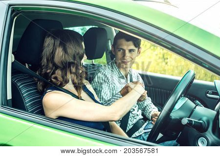 Instructor And Woman Student Driving Shaking Hands. Woman Passed The Exam In Driving School.
