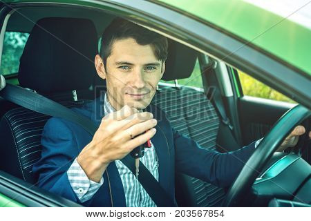 Happy Man In The Car. Keys In His Hands. Got A Driver License