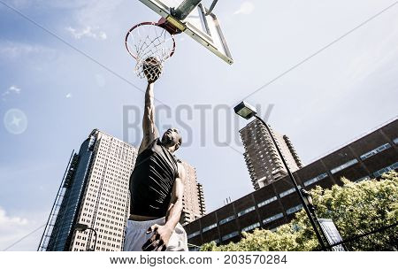 Basketball player making huge slam dunk on the court