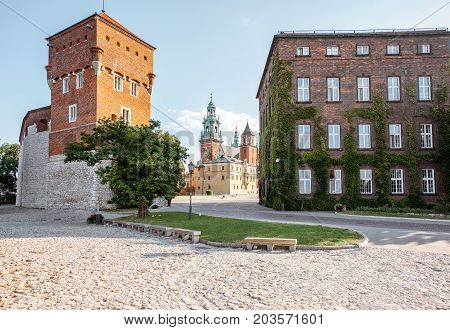 KRAKOW, POLAND - August 15, 2017: View on the inner courtyard of Wawel castle with Thieves tower during the sunny morning in Krakow