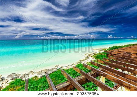 gorgeous amazing beautiful view from the top of the roof on tropical white sand beach and tranquil turquoise tender ocean on sunny summer day at Santa Maria island,Cuba