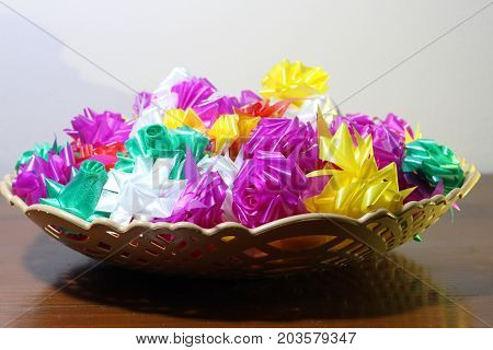 colorful ribbonsSet ribbon folded into a flower. Wrap coins by hand. for the sacred(ordination ,matriculation ,initiation) in Thailand