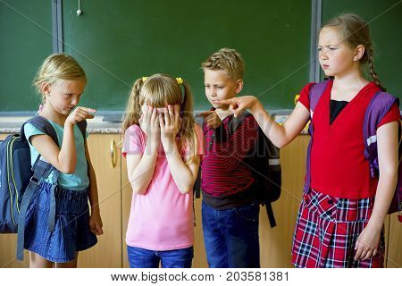 Group of kids is bullying a girl