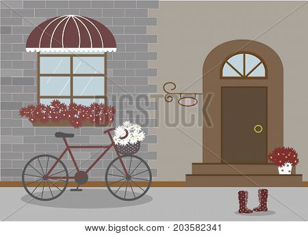 Pretty scenery in a rustic style. House, window with a striped awning, door, stairs, red flowers. Bike and basket of daisies. Rain boots with polka dots. Decorative brick wall. Vector illustration