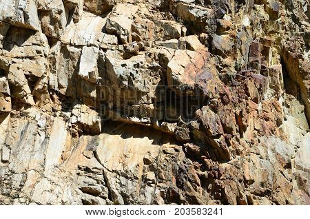 Rude rock in sunny day as background and texture