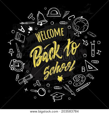 Welcome back to school. Hand-drawn lettering of yellow color surrounded by school supplies with on black background. Imitation of chalk drawing on the blackboard. Vector poster.