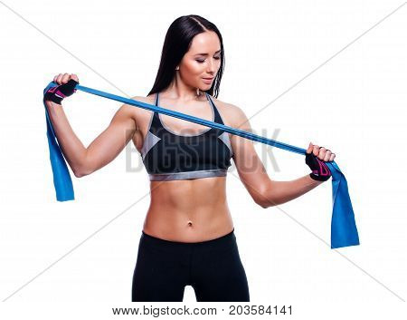 Fitness Girl Performs Exercises With Resistance Band. Attractive Young Woman Doing Exercises With Ex