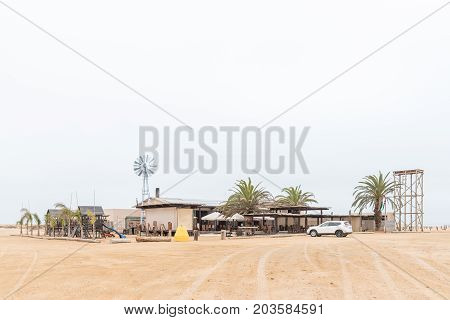 SWAKOPMUND NAMIBIA - JUNE 29 2017: Windpomp 14 (windmill 14) a camping site and restaurant in the Namib Desert to the North of Swakopmund on the Skeleton Coast of Namibia