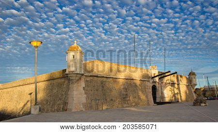 Old fortification of the city of Lagos Algarve Portugal. Evening picture with blue sky and small clouds. The place of overseas discoveries
