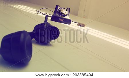 Background antique telephone Retro photo perspective dimension and oblique is art style Object on the white wood floor has sun lighting is nice shot.