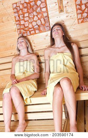 Beautiful Women In A Sauna.