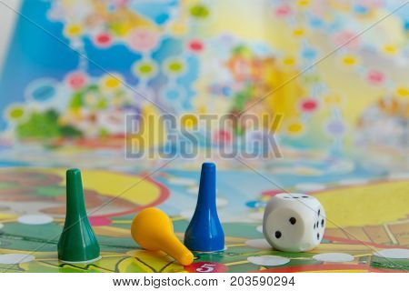 Blue yellow and green plastic chips dice and Board games for children .