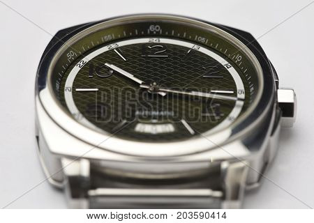 green dial automatic watch  and white backround