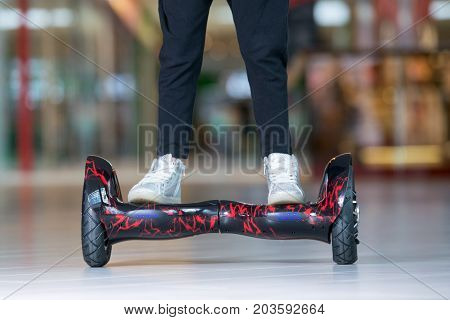 Girl Feet On The Hover Board. Self-balancing Scooter Or Mini Segway.