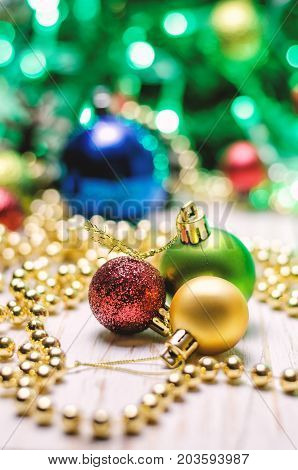 Christmas background with a red golden and green christmas balls.