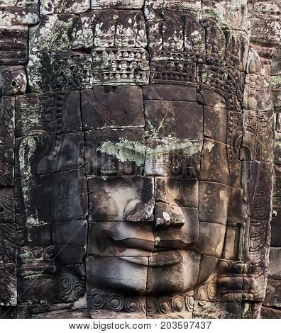 stone faces of king Bayon Temple Angkor Thom Cambodia. Ancient monument Khmer architecture Kampuchea.