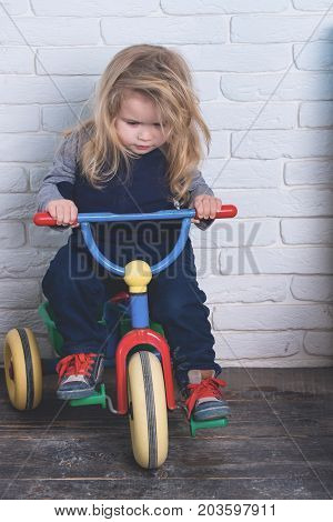 Boy Riding Bicycle In Room