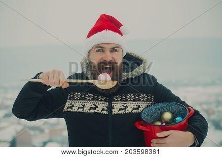 Santa Man Eating Xmas Balls On Snowy Landscape