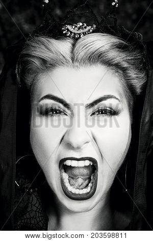 Evil Queen With A Crown In A Fantastic Portrait - Beautiful Mystical Princess In A Dark Cloak Of Dra