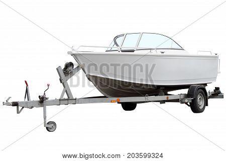 Modern motor boat isolated on the trailer for transportation.