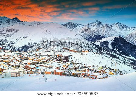 Amazing winter sunrise landscape and famous ski resort in French Alps Alpe D Huez France Europe