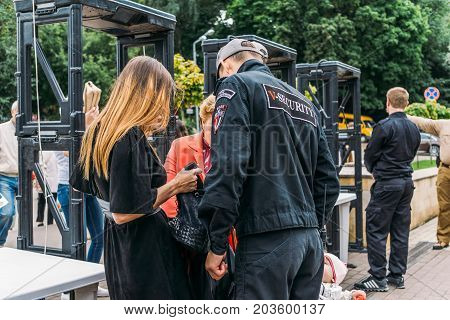 Voronezh, Russia - September 8, 2017: Security guards near metal detectors in a public place on a city holiday, Voronezh, Dynamo Park