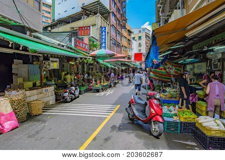 TAIPEI TAIWAN - JULY 05: This is a view of Tamsui old street traditional shops and street vendors which is popular amongst local people on July 05 2017 in Taipei