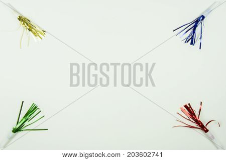Colorful Party Noise Makers Frame On White