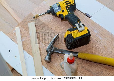 carpenter tools on wooden background tool drill hammer glue