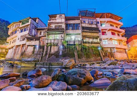 Old riverside architecture in the Shiding district at night