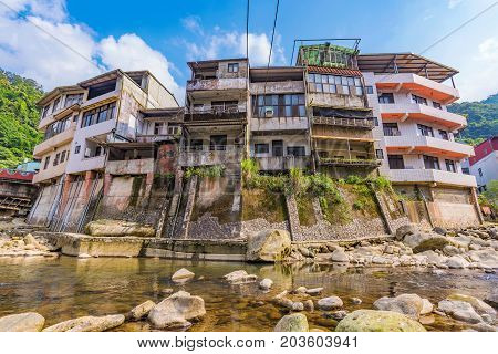 Riverside architecture and nature in Shiding street