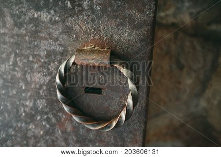 Steel knock door ring close up. Photo in the daytime.